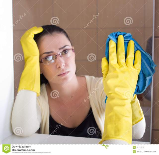 woman-cleaning-bathroom-mirror-tired-rubber-gloves-mop-61118820
